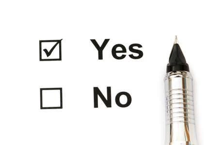 Pen and tick boxes with Yes and No options photo