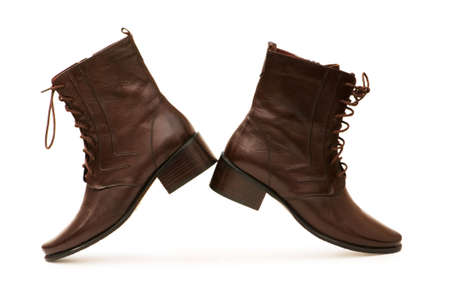 Brown boots isolated on the white background photo