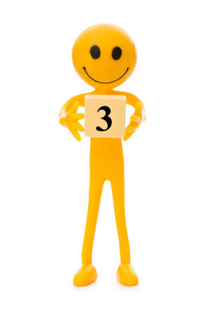 tabassum: Smiley  holding the number isolated on white