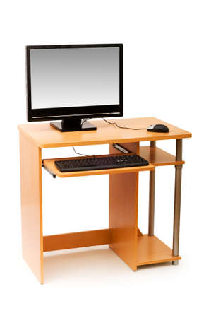 Computer and desk isolated on the white photo