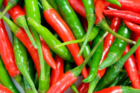 Red and green chili peppers at the background photo