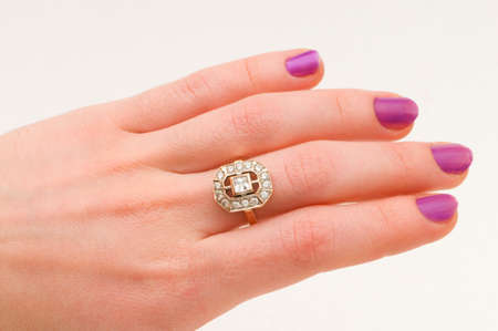 Hand with golden ring isolated on the white Stock Photo - 4356209