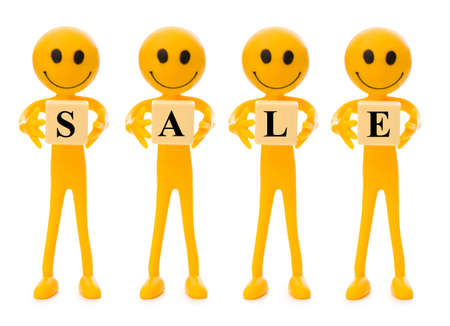 tabassum: Smilies holding word SALE isolated on white