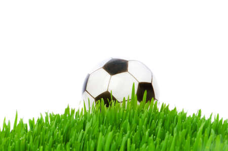 Sport concept - football on the green glass photo