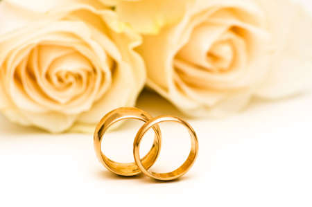 Roses and wedding ring isolated on the white photo