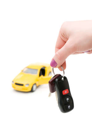 Car keys and car at background isolated on white photo