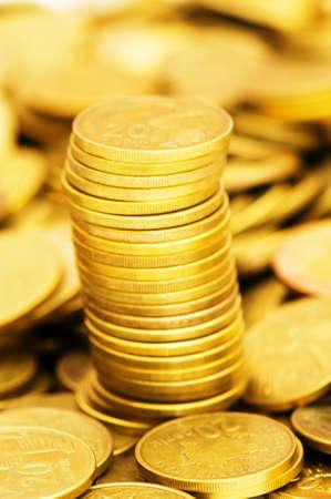 monies: Golden coins stack - shallow depth of field