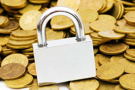 Concept of financial security with lock and coins Stock Photo - 4655301