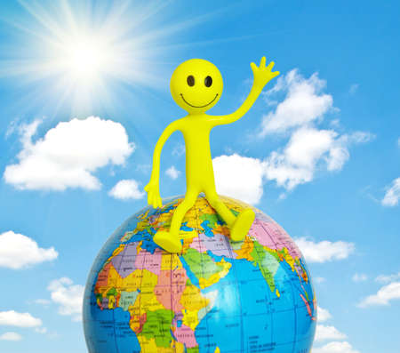 tabassum: On top of the world - smilie sitting on the globe