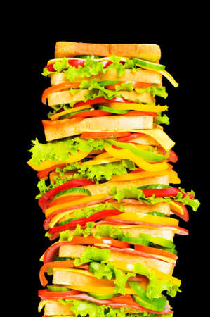 Tall sandwich isolated on the black background photo