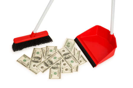 Brush sweeping dollars isolated on the white photo