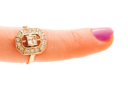 Finger with golden ring isolated on the white Stock Photo - 4789960