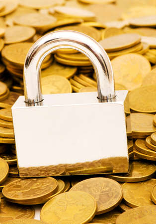 monies: Concept of financial security with lock and coins