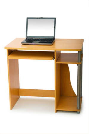 Laptop and desk isolated on the white background  photo