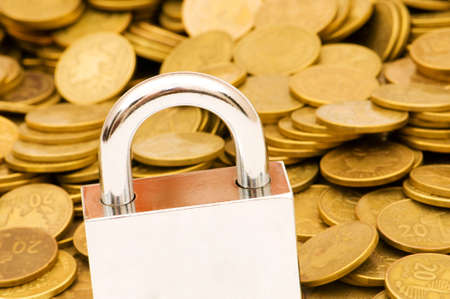 Concept of financial security with lock and coins Stock Photo - 4877185