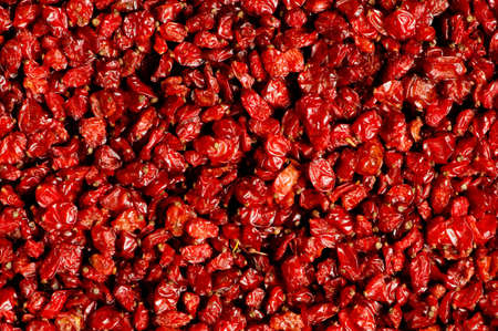 Background made of red dried raisins photo