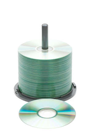 Spindle of cd disks isolated on white photo