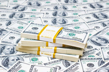 Background with many american hundred dollar bills photo