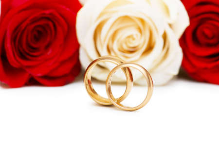 Roses and wedding ring isolated on the white Stock Photo - 5144230