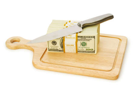 devaluation: Money concept - cutting dollars with the knife