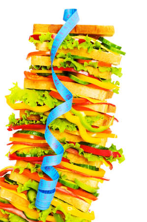 Concept of healthy food with tape measure and sandwich photo