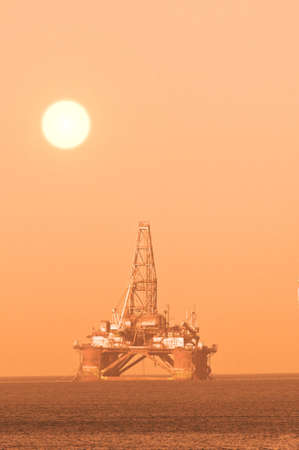 Oil platform during sunset photo