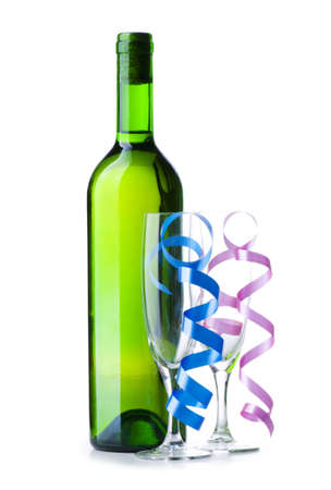 Bottle of wine and glass with streamer on white photo