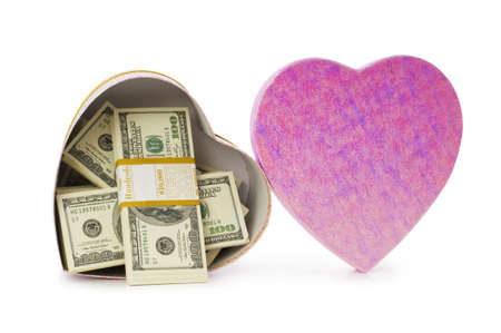 Heart shaped gift box and dollars inside photo