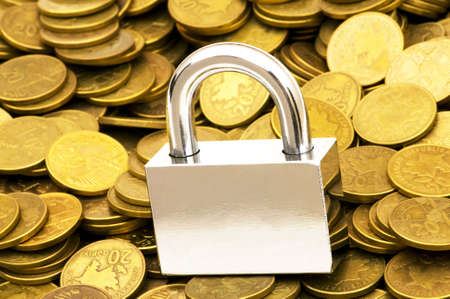 Concept of financial security with lock and coins Stock Photo - 5510342