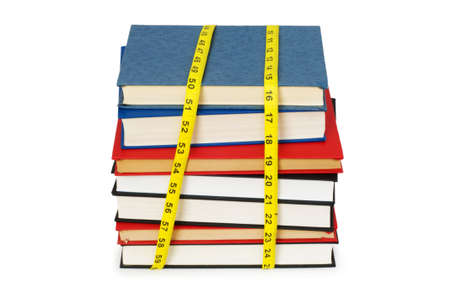 Measuring the knowledge - concept with books on white photo