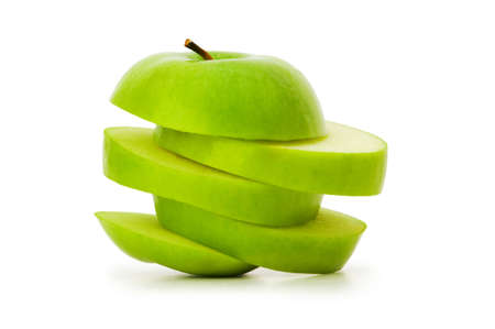 Sliced green apple isolated on white photo
