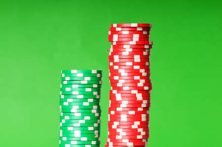 Stack of casino chips against green background photo