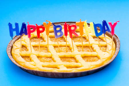 Happy birthday candles in the pie Stock Photo - 5718216