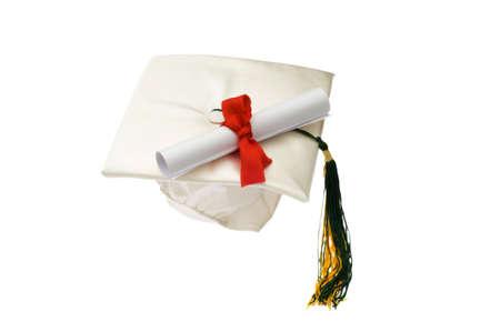alumni: Tapa de graduaci�n y diploma de aislados en blanco Foto de archivo