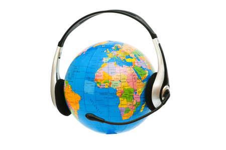 Headset on globe isolated on the white photo