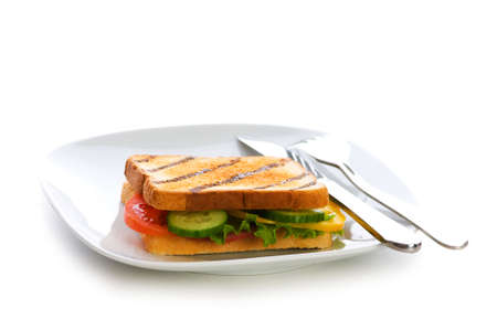 Toasted bread with filling isolated on the white Stock Photo - 5778486
