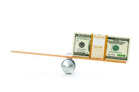 Financial concept - balancing economy with dollars Stock Photo - 5778484