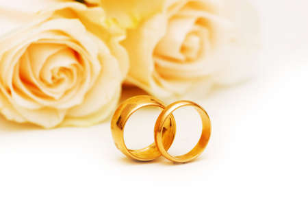 Wedding concept with roses and golden rings Stock Photo - 5778322
