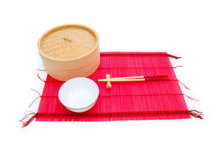 Chopsticks and bowl on the bamboo mat photo