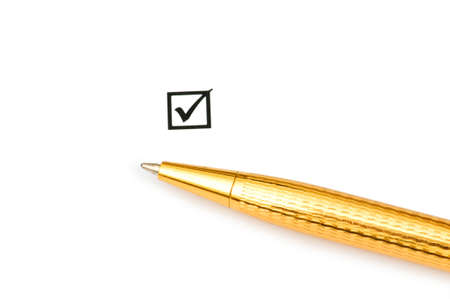 Tick in the box and golden pen Stock Photo - 5778459