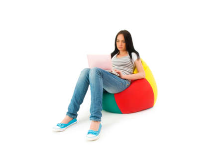 Girl working on laptop isolated on white Stock Photo - 5802674