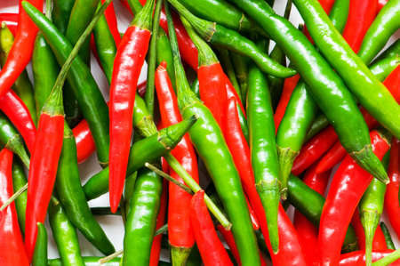 capsaicin: Red and green chili peppers Stock Photo