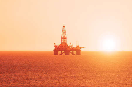 azerbaijan: Oil platform at the sunrise