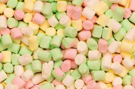 Various dry colourful sweets arranged as background photo