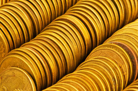 monies: Close up of the golden coin stacks