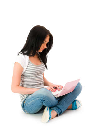 Girl working on laptop isolated on white Stock Photo - 5856387