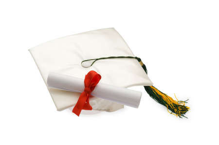 Graduation cap and diploma isolated on white photo