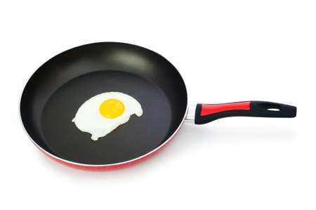 Frying pam with fried egg isolated on white Stock Photo - 5922808