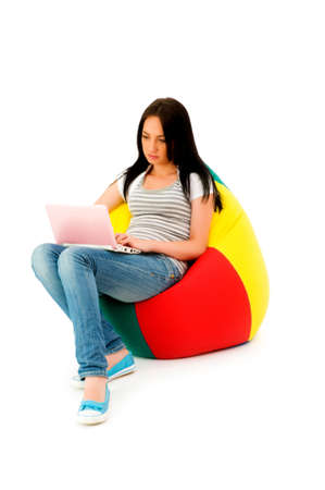 netbook: Girl working on laptop isolated on white