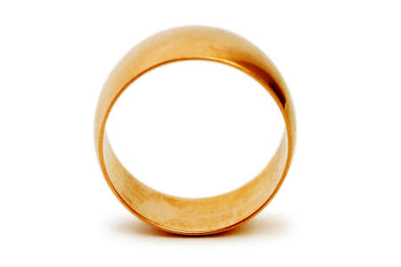 Golden ring isolated on the white background photo